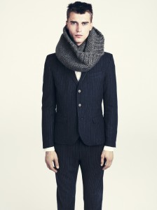 """A heavy knit scarf or parka over a classic suit adds attitude"""