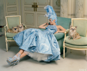 Kate Moss with dog models in Vogue - image sourced from Paper Magazine's Twitter gallery