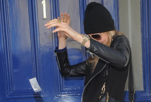 Screen Shot of Delevingne with suspiscious looking bag - sourced from MailOnline